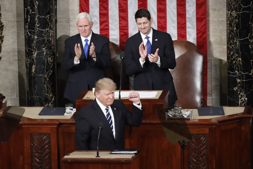 President Trump and the Republican-majority Congress have overturned 14 Obama-era regulations. He's shown with Vice President Mike Pence, left, and House Speaker Paul D. Ryan.