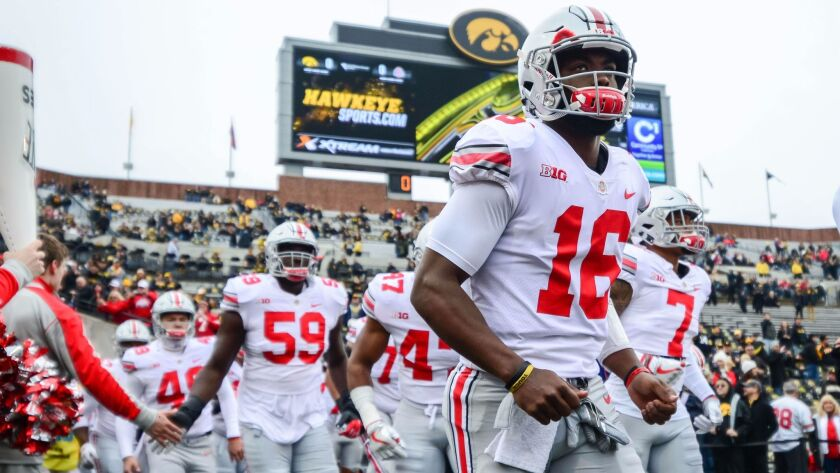 Ohio State Buckeyes quarterback J.T. Barrett (16) and teammates enter the field before the game against the Iowa Hawkeyes at Kinnick Stadium.