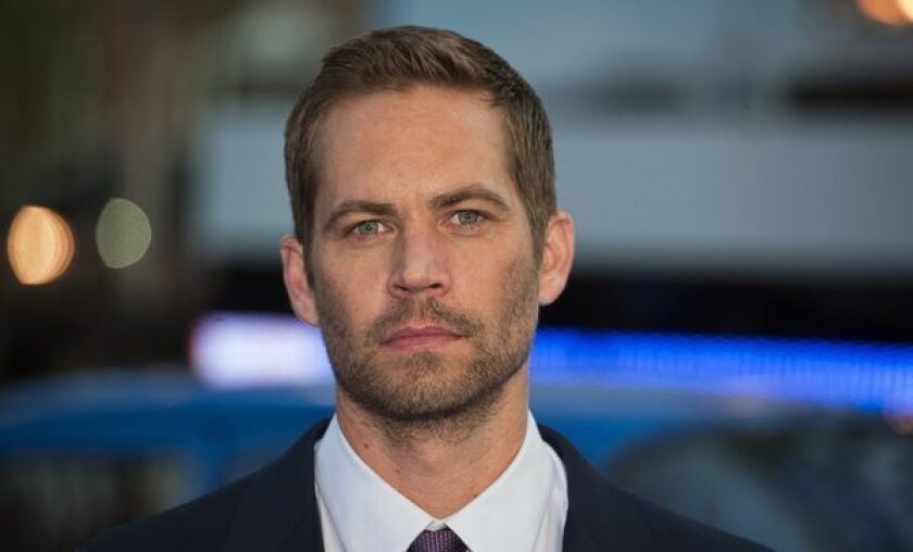 "Actor Paul Walker arrives for the world premiere of ""Fast and Furious 6"" in London. Universal Productions scrapped production of ""Fast & Furious 7,"" which had been filming in Georgia."