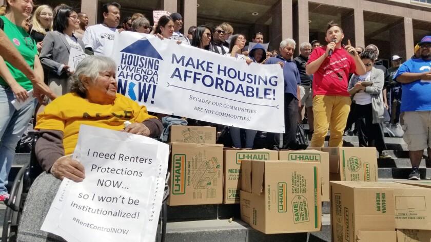 Mike Van Gorder, a member of the Glendale Tenants Union, speaks alongside renters from southern Cali