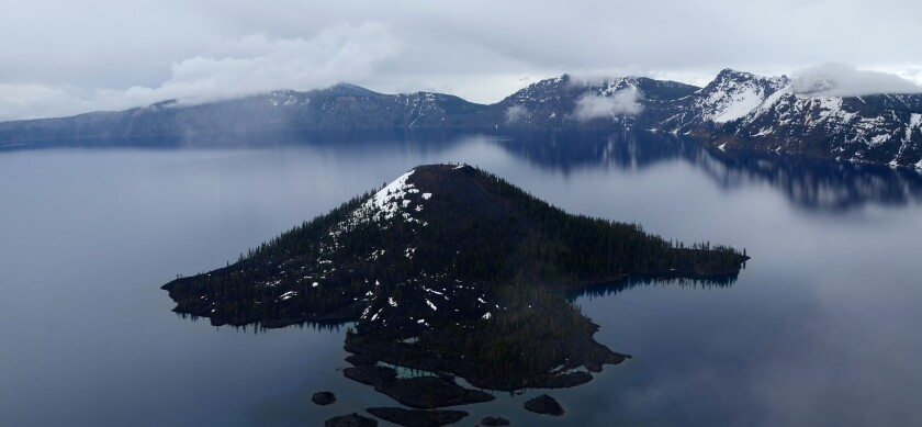 This is Wizard Island, seen from Watchman Overlook above Crater Lake in Oregon.