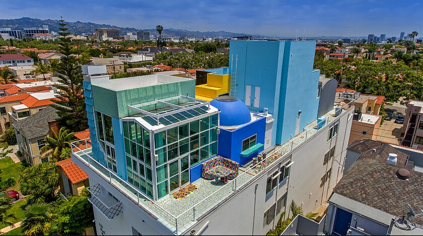 The offbeat Home of the Week penthouse in Beverly Hills was designed in the 1980s by noted architect Frank Gehry using unusual shapes and forms to evoke a small city.