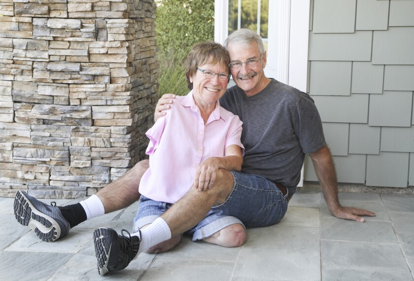 Author Linda Olson and her husband, Dave Hodgens,  pose for photos at their La Jolla home.