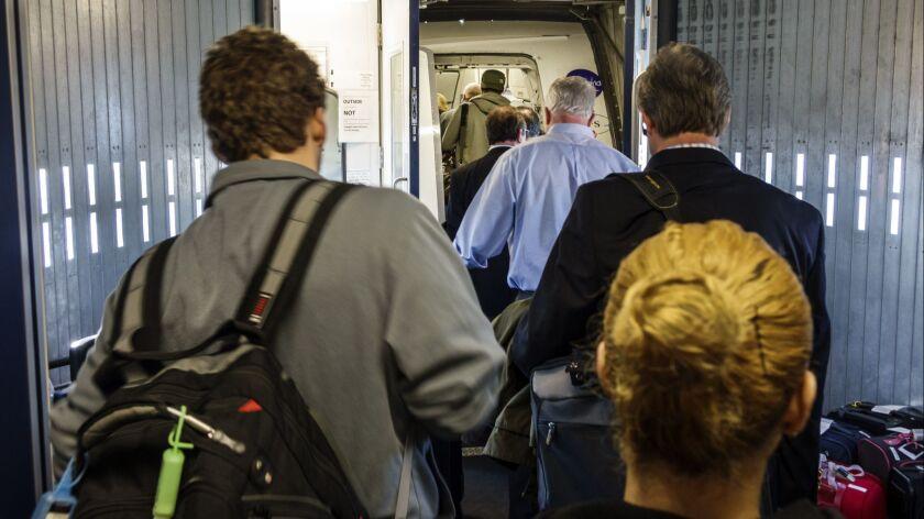 Passengers boarding a US Airways flight at John F. Kennedy International Airport.
