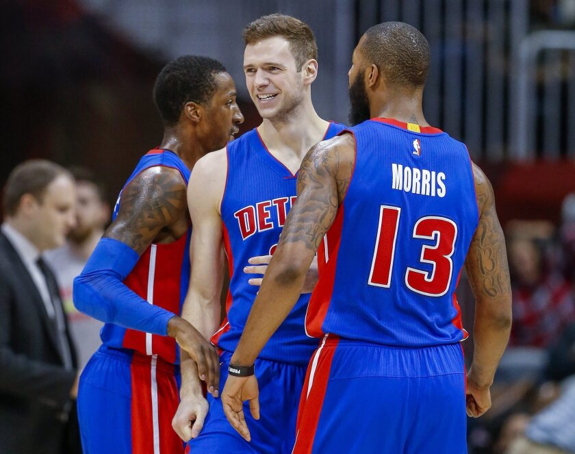 Detroit Pistons players, forward Jon Leuer (C) reacts with forward Marcus Morris and guard Kentavious Caldwell-Pope (L) during the second half of their NBA basketball game against the Atlanta Hawks at Philips Arena in Atlanta, Georgia, USA, 02 December 2016. The Pistons defeated the Hawks. (