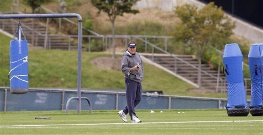 New England Patriots head coach Bill Belichick watches as his team warms up during practice at the NFL football team's facility in Foxborough, Mass., Wednesday afternoon, Oct. 12, 2011. (AP Photo/Stephan Savoia)