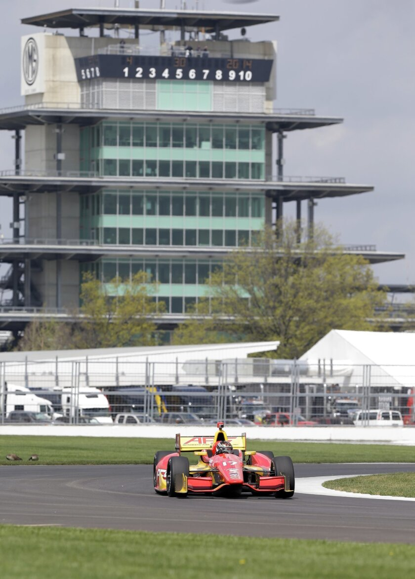Sebastian  Saavedra, of Colombia, takes a turn during testing for the inaugural Grand Prix of Indianapolis auto race on the new road course at Indianapolis Motor Speedway in Indianapolis, Wednesday, April 30, 2014. (AP Photo/Michael Conroy)