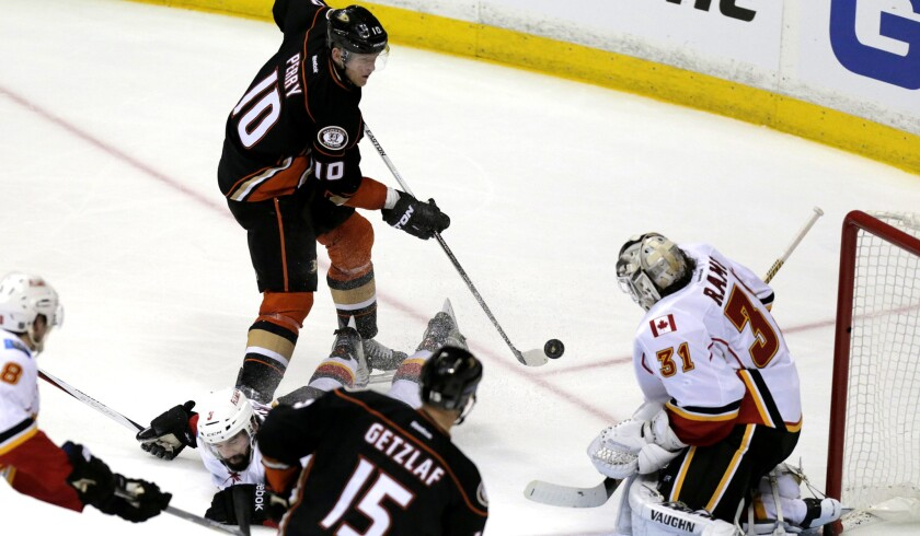 Ducks right wing Corey Perry (10), who had two goals and two assists in Game 1, takes a shot against Flames goalie Karri Ramo in the third period Thursday night.