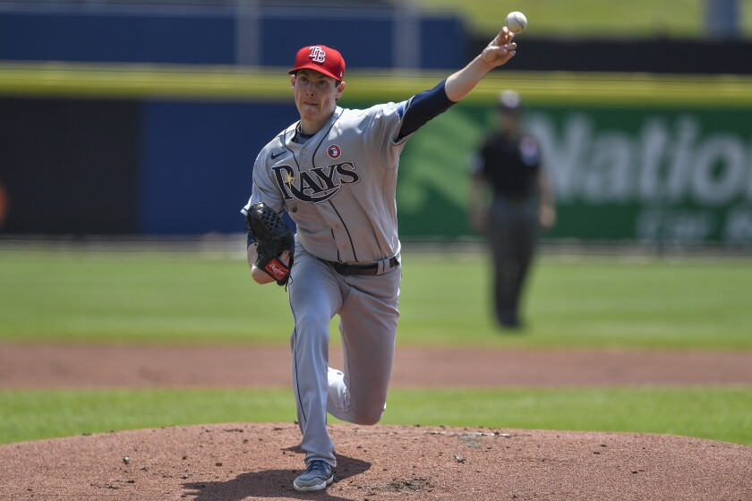Tampa Bay Rays starting pitcher Ryan Yarbrough throws to a Toronto Blue Jays batter during the first inning of a baseball game in Buffalo, N.Y., Sunday, July 4, 2021. (AP Photo/Adrian Kraus)