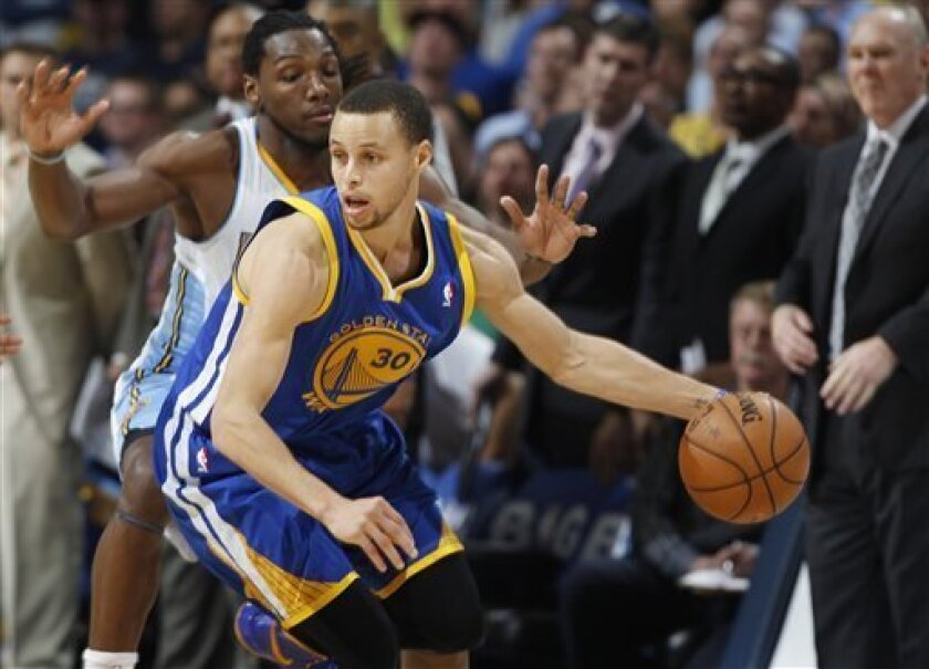 Golden State Warriors guard Stephen Curry (30) is pressured by Denver Nuggets forward Kenneth Faried in the fourth quarter of Game 5 of their first-round NBA basketball playoff series, Tuesday, April 30, 2013, in Denver. The Nuggets won 107-100. (AP Photo/David Zalubowski)