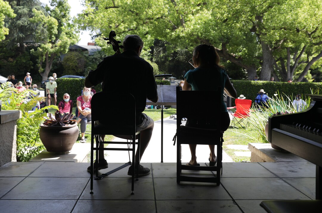 Jonathan and Catherine Karoly perform for a social-distanced crowd on their lawn in Pasadena.