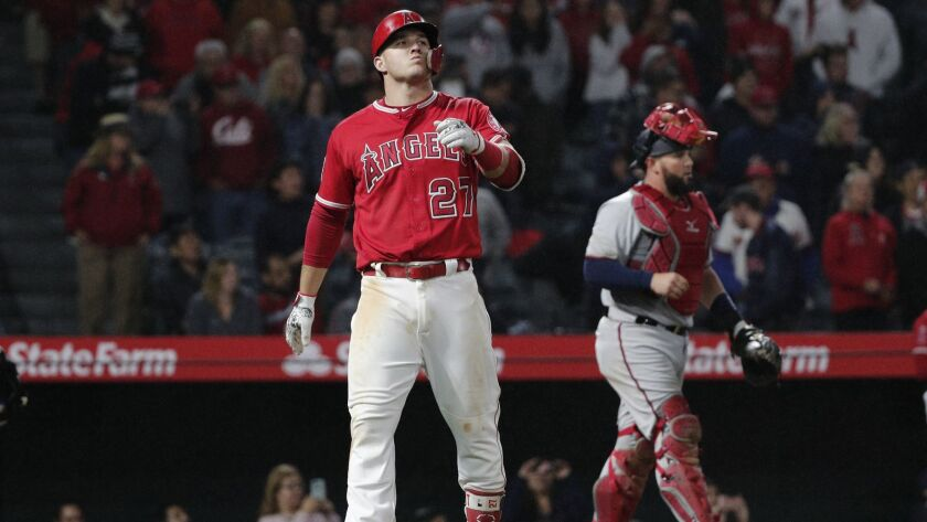 """Mike Trout reacts as shortstop Gregorio Petit catches his 118.0-mph line drive to end Friday's game. Says Minnesota Twins catcher Bobby Wilson, right: It's a distinctive sound that I only hear with certain guys, and those guys happen to be really, really good."""""""