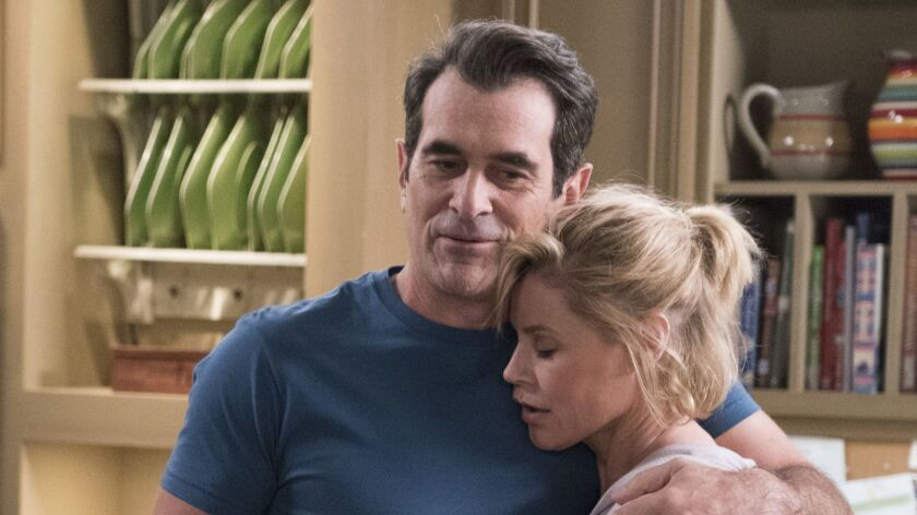"""Ty Burrell, left, as Phil and Julie Bowen as Claire in a scene from """"Modern Family."""""""