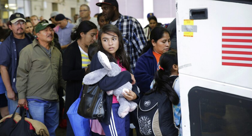 Immigrants from El Salvador and Guatemala board a bus after they were released from a family detention center in San Antonio last year.