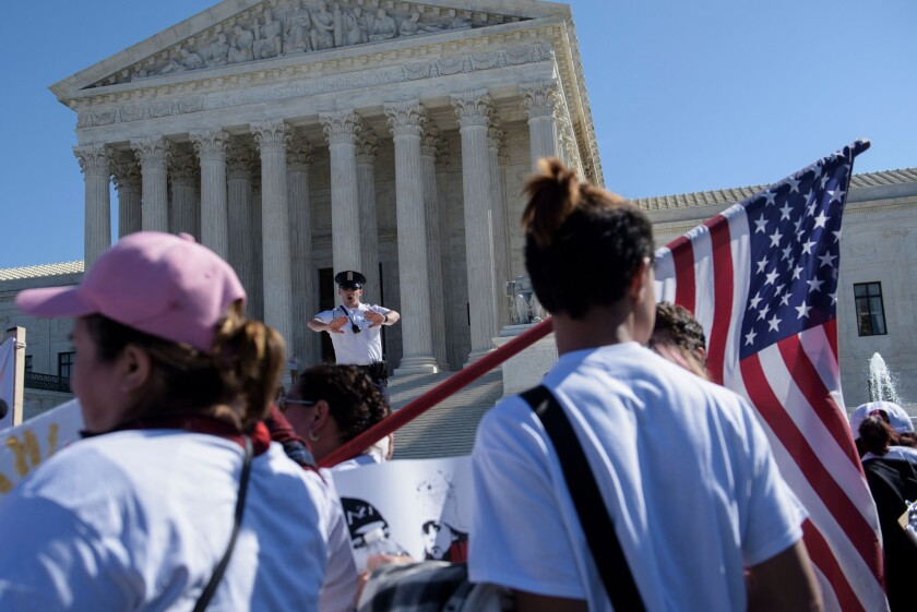 Activists gather during a March 18 immigration rally outside the Supreme Court.
