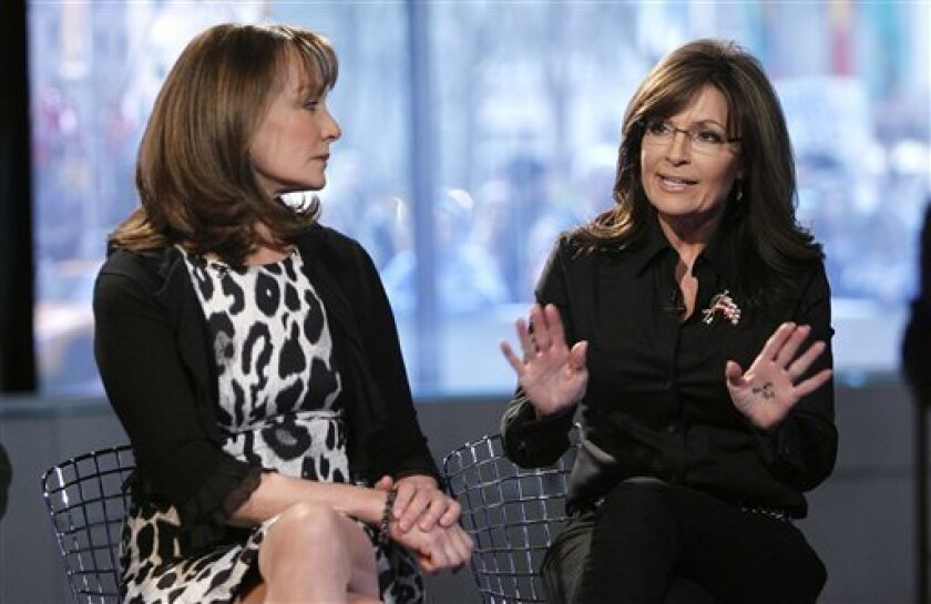 """Sarah Palin, who is co-hosting NBC News' """"Today"""" show, talks as Dr. Nancy Snyderman sits next to her in New York on Tuesday, April 3, 2012. Palin was the much-hyped guest co-host on NBC's """"Today,"""" going head-to-head against former """"Today"""" anchor Katie Couric, who this week is subbing on """"Good Morning America"""" at her current workplace, ABC. (AP Photo/NBC, Peter Kramer)"""