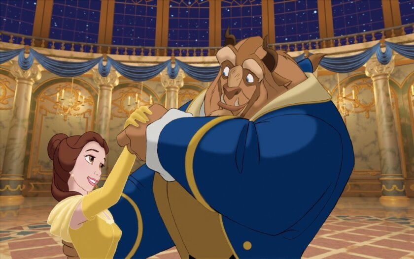 """Belle, voiced by Paige O'Hara, and the Beast, voiced by Robby Benson, appear in a scene from the animated classic, """"Beauty and the Beast"""""""