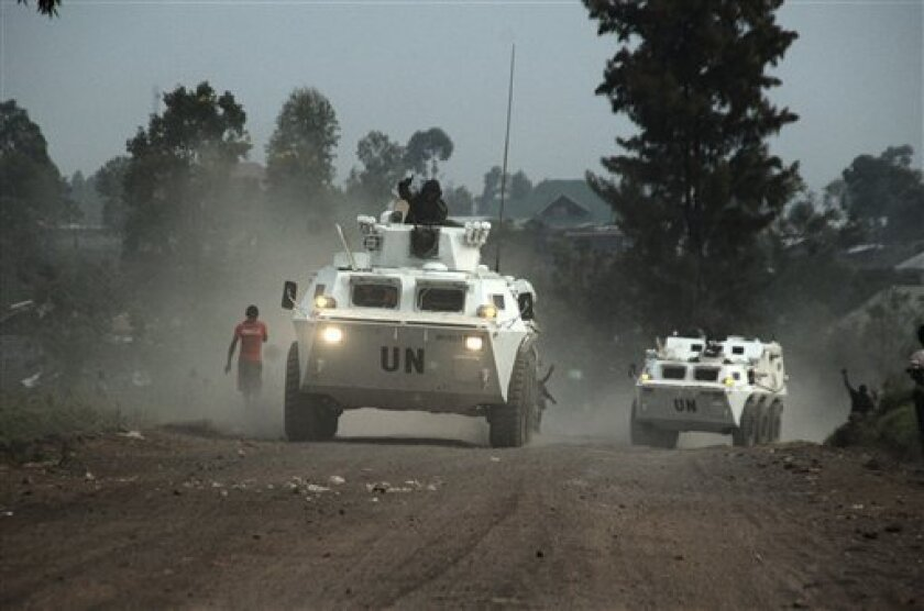 United Nations armored personnel carriers heading toward the front drive into Munigi, just north of the provincial capital of Goma, eastern Congo, Friday, Aug. 30, 2013. Rebels entrenched in the hills above one of eastern Congo's largest cities declared a unilateral ceasefire on Friday and began retreating from the frontline, the first indication that a joint United Nations and Congolese offensive might be gaining the upper hand in the conflict. Created in 2012, the M23 rebels succeeded in seizi