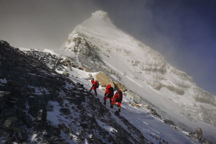 Members of a Chinese surveying team head for the summit of Mt. Everest.