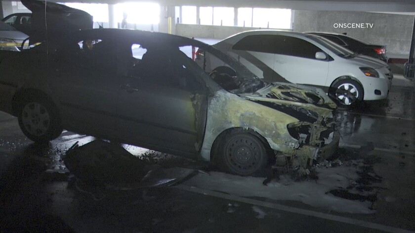 A fire damaged a car in a parking structure at San Diego City College Tuesday.