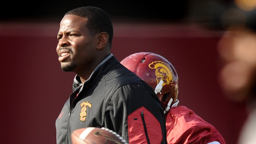 Kenechi Udeze helps conduct practice in preparation for the Trojans' bowl game.