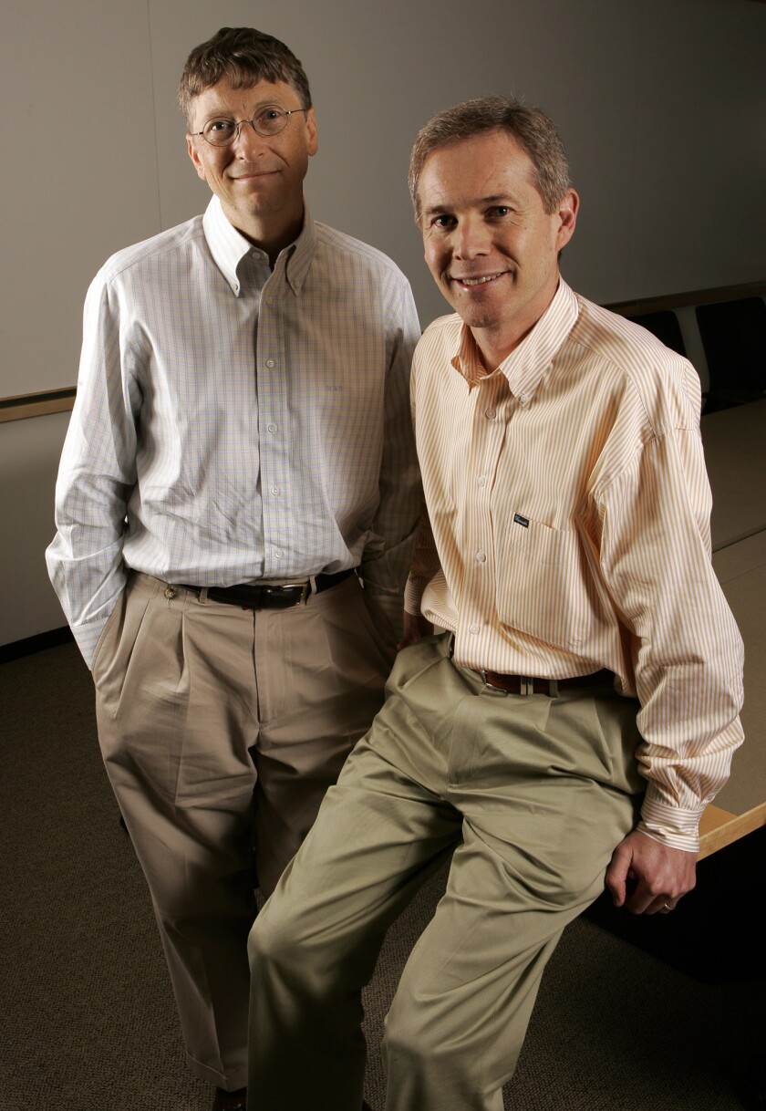 Microsoft Chairman Bill Gates, left, is pictured with Blair Westlake, Microsoft's vice president of media and entertainment. Westlake has announced he is leaving the software company.