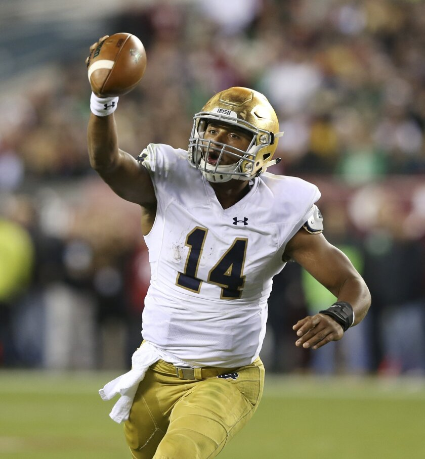 Notre Dame quarterback DeShone Kizer (14) looks to throw a pass during the second half of an NCAA college football game against Temple Saturday, Oct. 31, 2015, in Philadelphia. Notre Dame  won 24-20. (AP Photo/Mel Evans)