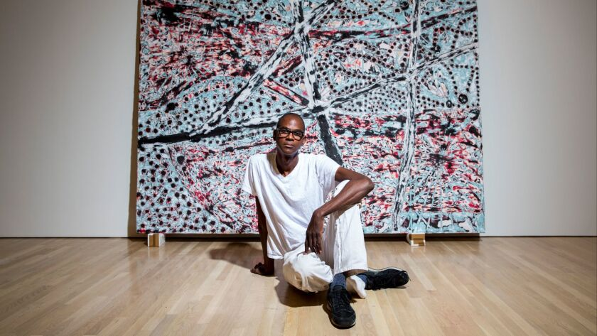 Mark Bradford installs a show at the Hammer Museum in 2015.