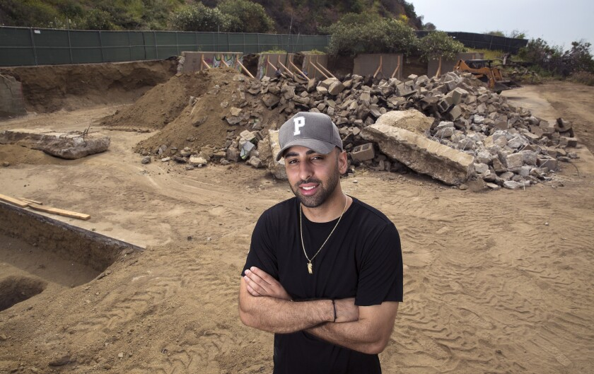 Neima Khaila stands on the site of a basketball court under construction in Runyon Canyon Park.