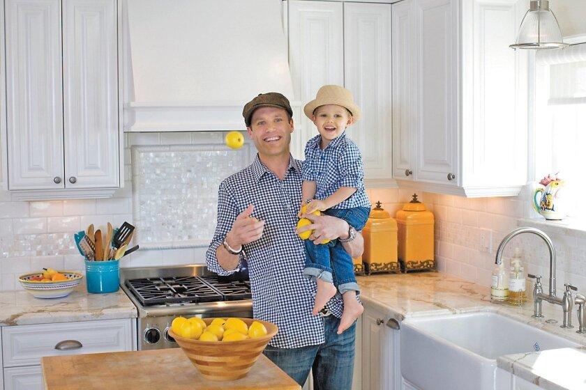 Searsucker chef Brian Malarkey with his 2-year-old son, Hunter, in the family's newly remodeled kitchen.