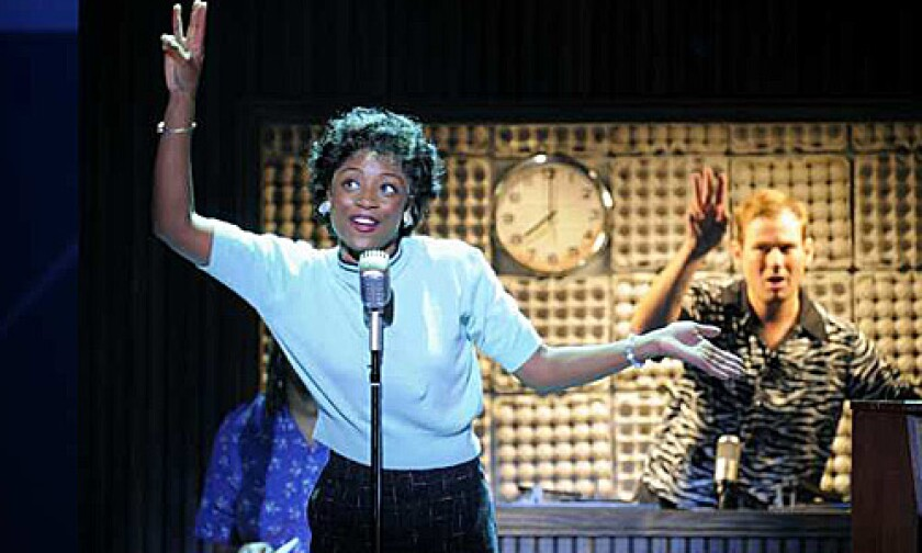 "'MEMPHIS': Montego Glover (as Felicia) sings ""Someday"" while Chad Kimball (as Huey Calhoun) cues from the radio booth."
