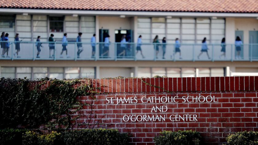 TORRANCE, CALIF. - DEC. 11 2018. Exterior of St. James Catholic School in Torrance. Two nuns alle