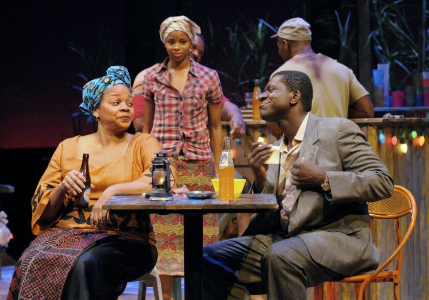 "Mama Nadi (Tonye Patano, left) shares a moment of levity with Christian (Oberon K.A. Adjepong, right) under the gaze of Sophie (Carla Duren), in La Jolla Playhouse's ""Ruined."""