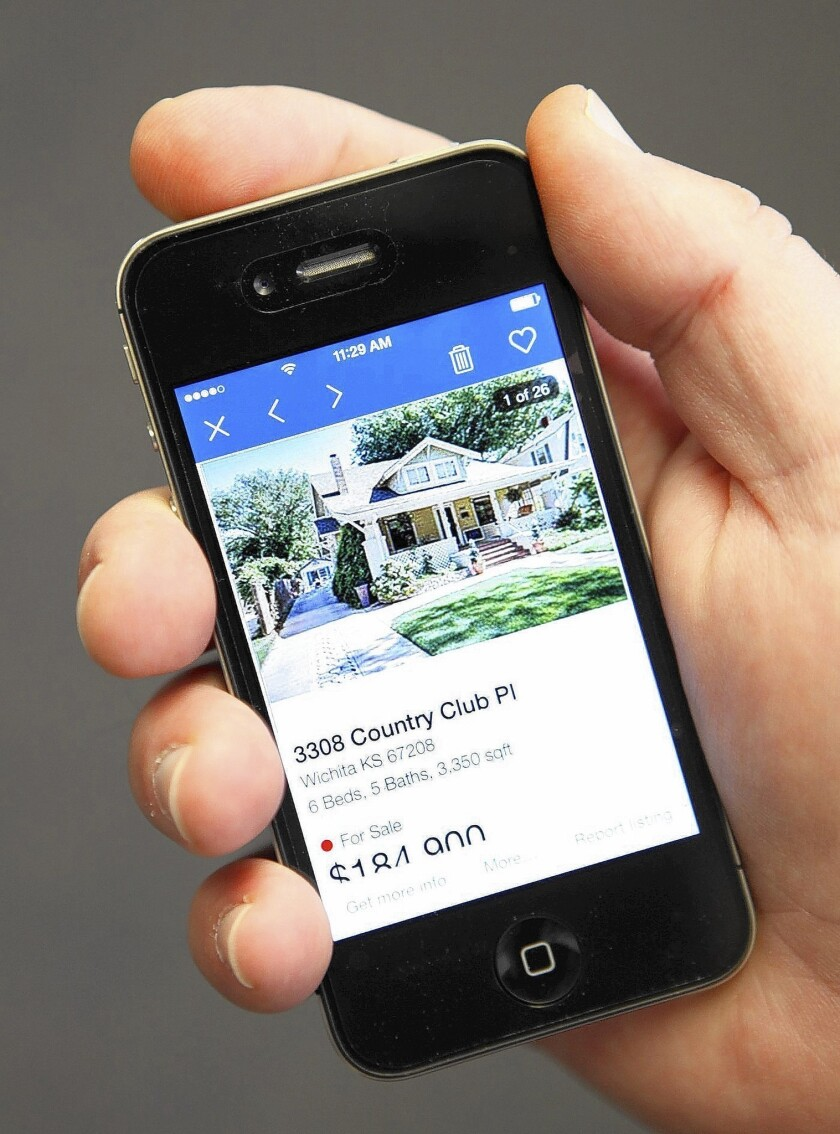 Some house hunters use the Zillow app to search for a home. Zillow is reportedly in talks to buy rival real estate website Trulia in a deal worth as much as $2 billion.