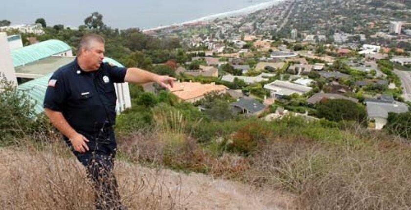 Eddie Villavicencio points out potential trouble spots on Mount Soledad. Photo: Dave Schwab