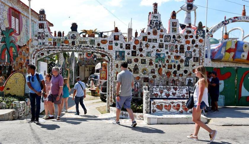 Tourists visit the studio and workshop of Cuban artist Jose Antonio Rodriguez Fuster on March 13, 2019, an artist whose surrealist figures, inspiring phrases, colors and infinite curves created in rich mosaics have made Havana's once run-down Jaimanitas neighborhood a major tourist attraction. EFE-EPA/Ernesto Mastrascusa