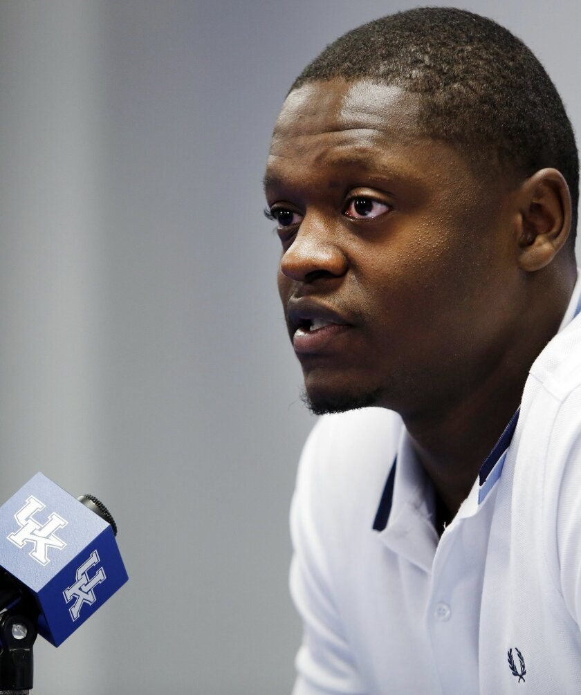 Kentucky's Julius Randle announces he will enter his name in the NBA draft during a news conference in Lexington, Ky., Tuesday, April 22, 2014. (AP Photo/James Crisp)