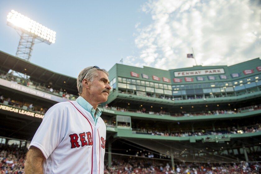 Former Boston Red Sox player Bill Buckner is introduced during a 1986 20-year team reunion before a game between the Boston Red Sox and the Colorado Rockies on May 25, 2016, at Fenway Park in Boston.