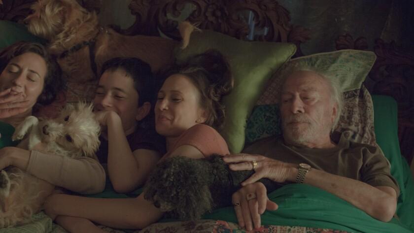 "Kristen Schaal, left, Lewis MacDougall, Vera Farmiga and Christopher Plummer in the movie ""Boundaries."""