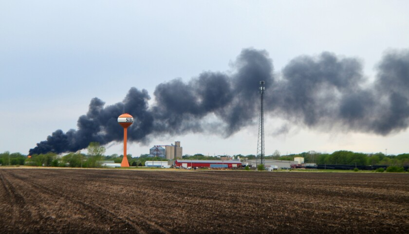 Smoke billows from a train derailment, Sunday, May 16, 2021, in Sibley, Iowa. Union Pacific spokeswoman Robynn Tysver said about 47 railcars came off the tracks during the derailment, but the train crew was not injured. (Mason Dockter/Sioux City Journal via AP)