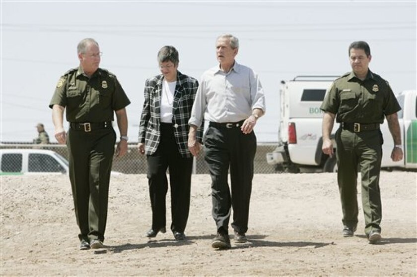 In this May 18, 2006 file photo, Homeland Security Secretary-designate, Ariz. Gov. Janet Napolitano, second from left, walks with, from left, Ron Colburn, Yuma Sector chief; President Bush and Border Patrol Chief David Aguilar during a tour of the Yuma Sector Border along the U.S. Mexico Internati