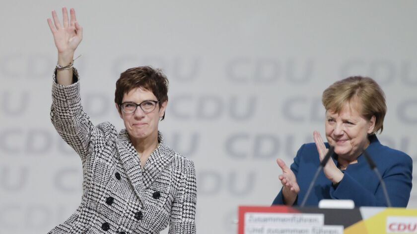 German Chancellor Angela Merkel, right, congratulates newly elected party Chairwoman Annegret Kramp-Karrenbauer after the election at the Christian Democratic Union convention in Hamburg on Dec. 7, 2018.