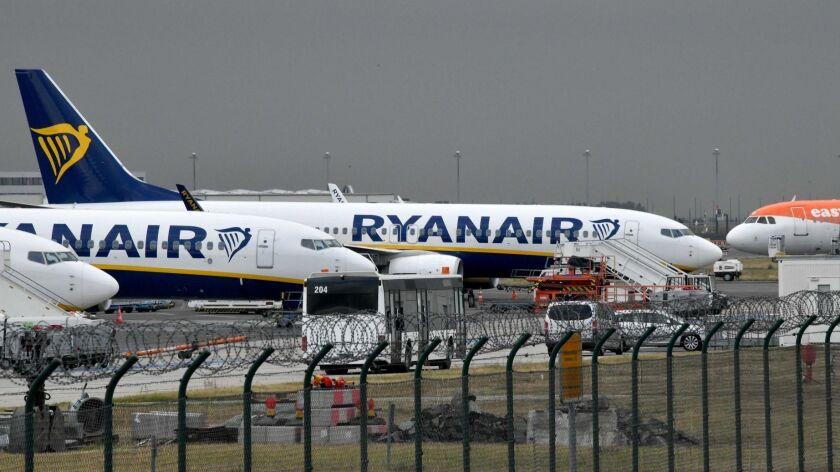 Planes of Irish airline Ryanair stand on the tarmac.