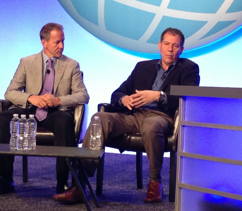 Glenn Johnson, president of Horizon Air (left), and Craig Kreeger, CEO of Virgin Atlantic Airways, discuss current trends in the airline industry at the Global Business Travel Association convention in San Diego.