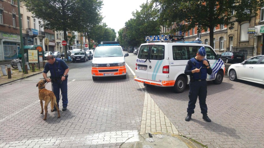 Belgian police stand guard in the Etterbeek district of Brussels, where two terrorists lived before the March 22 attack on the city's subway.