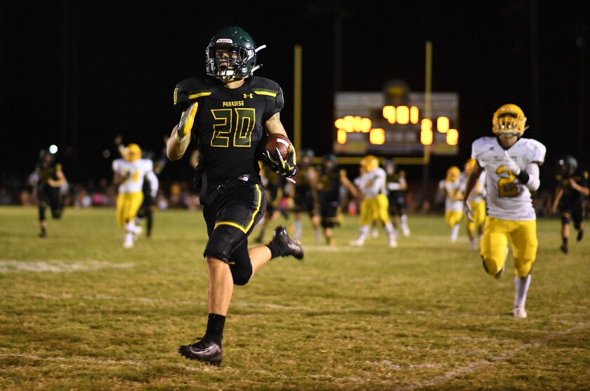 Paradise's Lukas Hartley runs with the ball during Friday's game against Williams.
