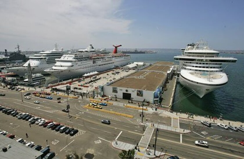 The Sapphire Princess' (right) arrival in San Diego yesterday morning marked the first of at least 12 cruise ships that are set to dock in San Diego instead of at Mexican ports because of the swine flu outbreak.  (John Gibbins / Union-Tribune)