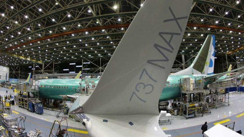 A Boeing 737 Max is assembled at the company's Renton, Wash., plant in 2015. After two fatal crashes, the planes have been grounded and production is being suspended.