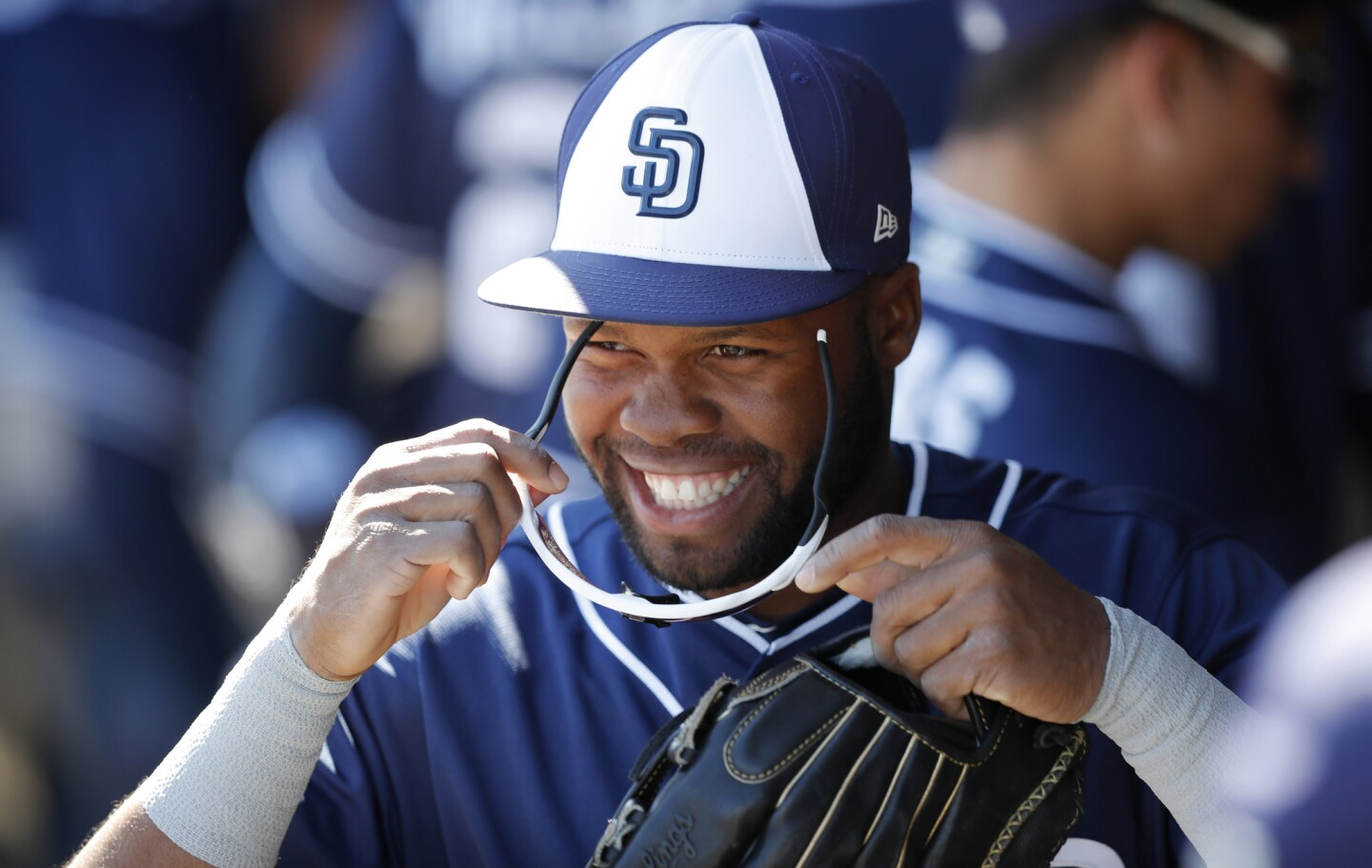 San Diego Padres' Manuel Margot walks in the dugout during the first inning of a spring training baseball game against the Texas Rangers, Thursday, March 1, 2018, in Surprise, Ariz. (AP Photo/Charlie Neibergall)