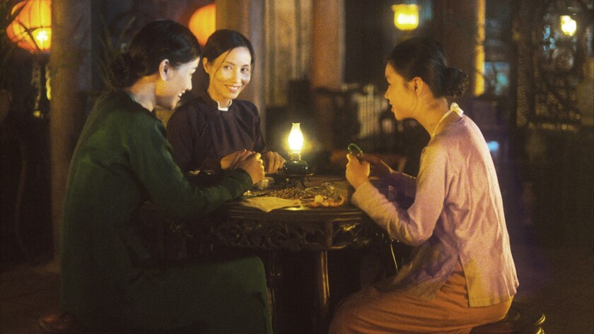 "Mai Thu Huong Maya, left, Nguyen Nhu Quynh and Nguyen Phuong Tra My in the movie ""The Third Wife."""